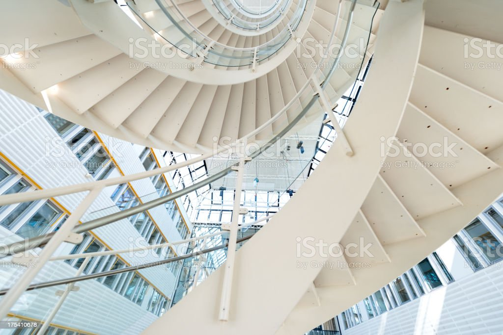 Spiral staircase inside office Complex stock photo
