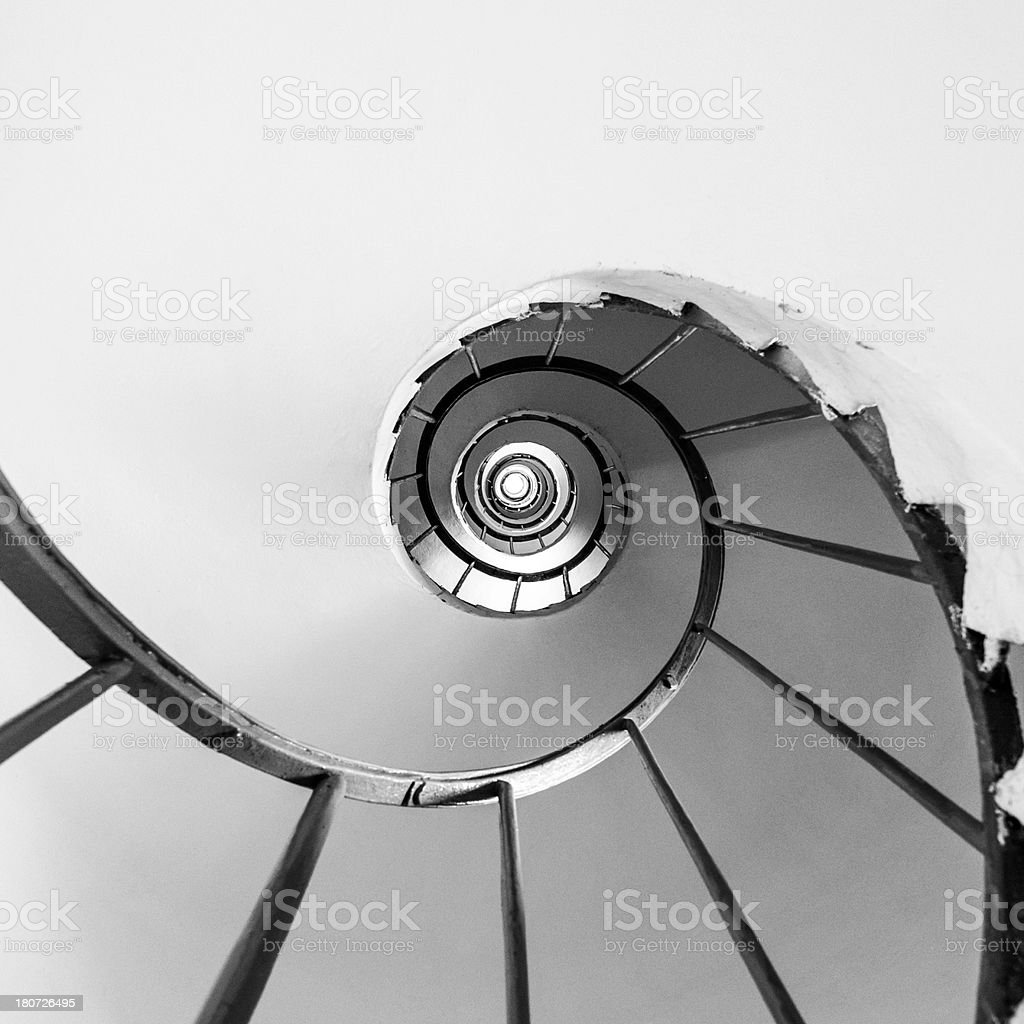 Spiral staircase, tower interior, directly below, black and white royalty-free stock photo