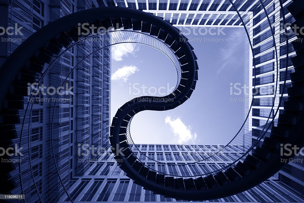 spiral stiars in front of modern architecture royalty-free stock vector art