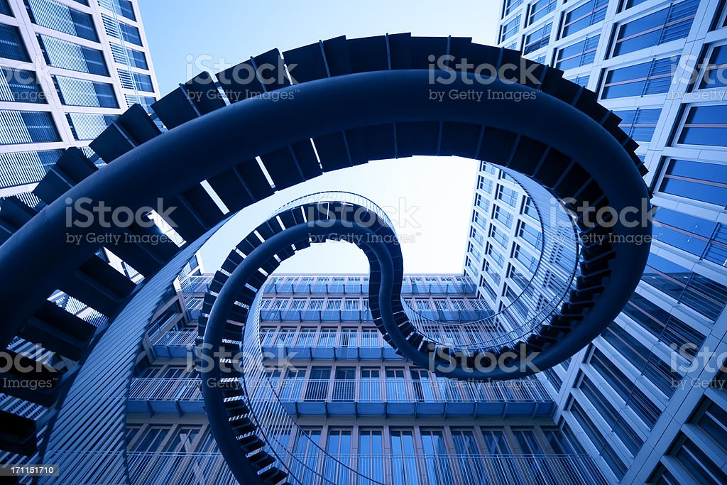 spiral stiars in front of modern architecture stock photo