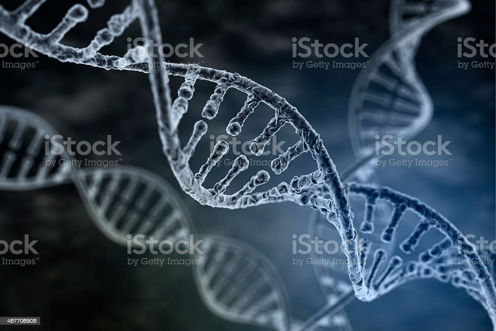 Spiral strand of DNA on the dark background stock photo