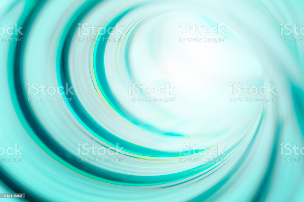 Spiral tunnel with strong light at the end stock photo