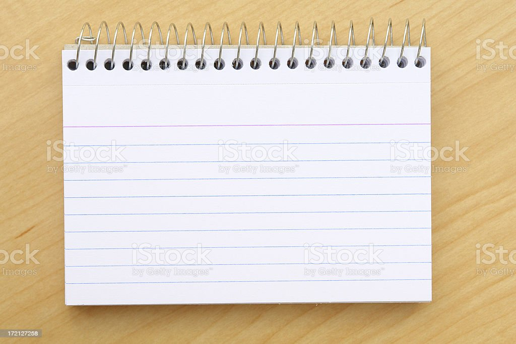Spiral white note pad on wood desk royalty-free stock photo