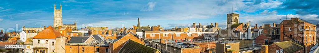 Spires and cathedral bell towers across rooftop panorama Gloucester UK stock photo