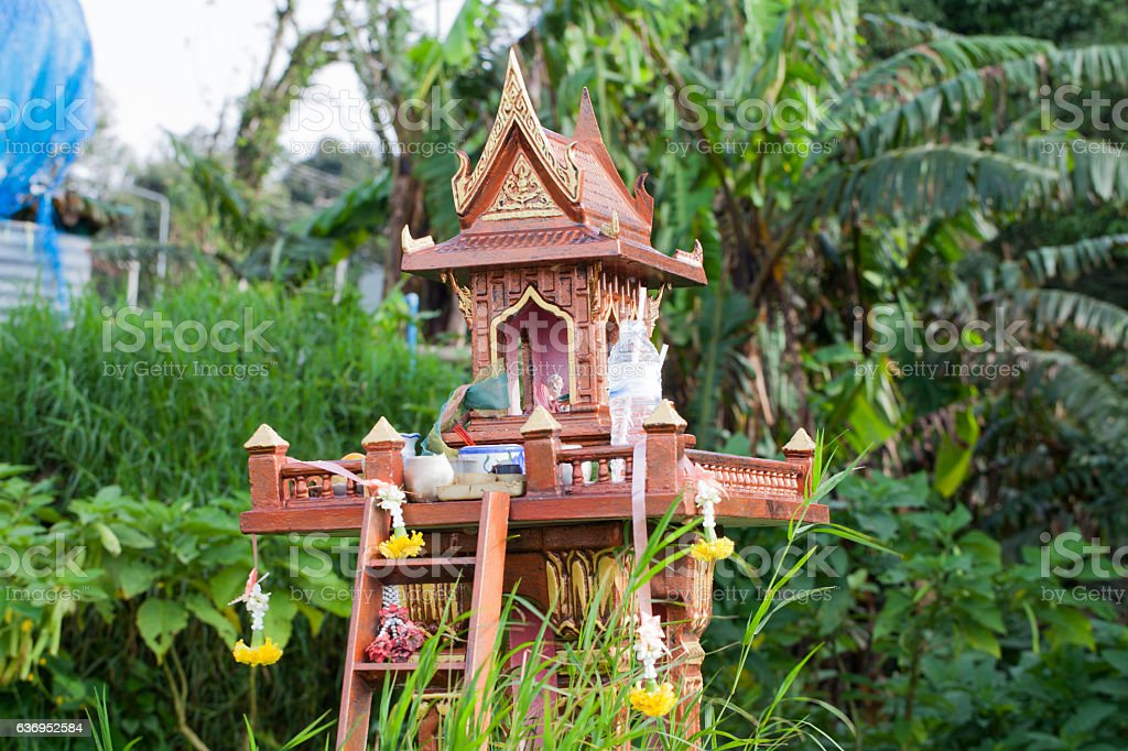 spirit house in thailand with garland  some wreathes joss house stock photo