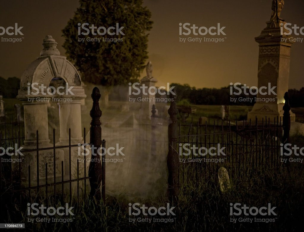 Spirit in the Material World Ghost haunting graveyard stock photo