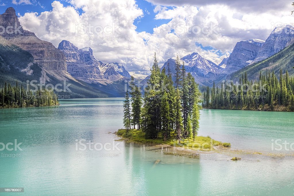 Spirit island with mountains in the background stock photo