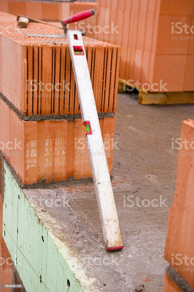 Spirit Level Leans on Wall royalty-free stock photo