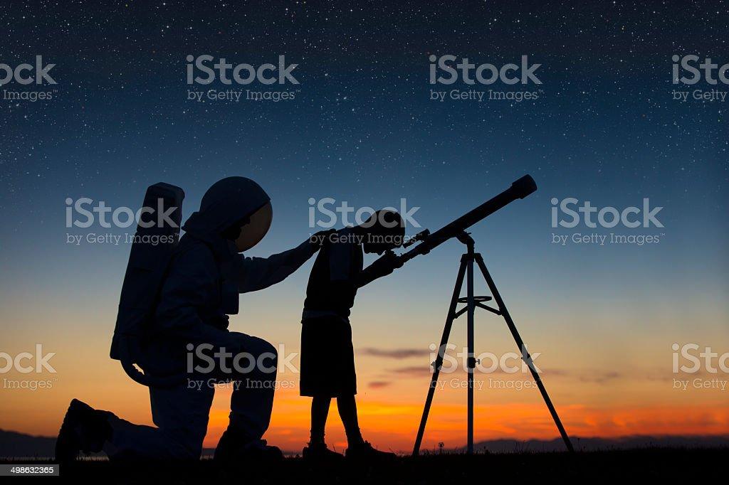Spirit of an Astronaut, Boys looking thru a telescope stock photo