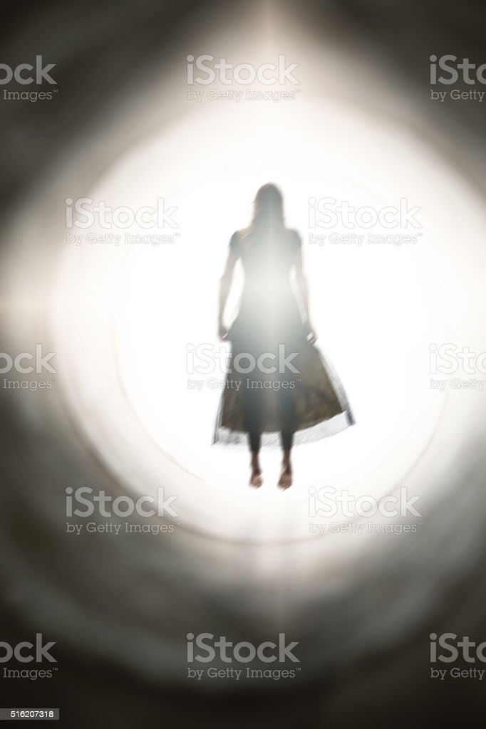 Spirit Of Woman Bathing In Light stock photo