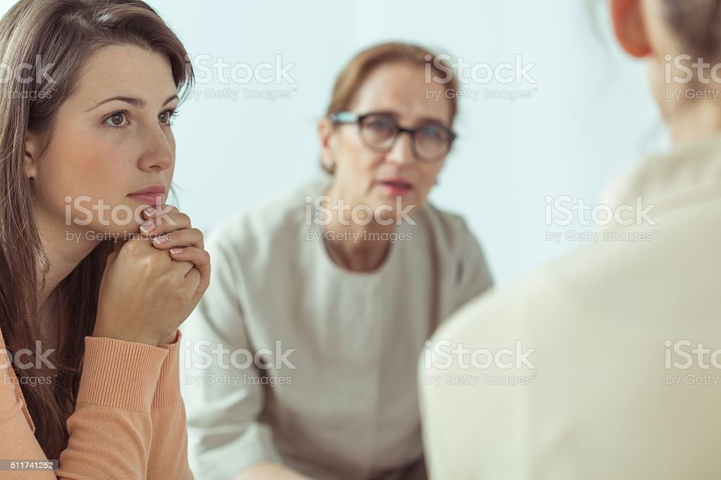 Spiritual guide talking with women stock photo