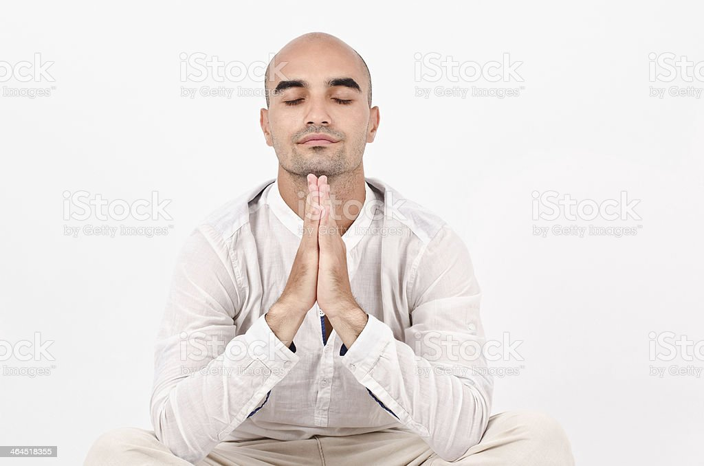 Spiritual man praying and meditating. royalty-free stock photo