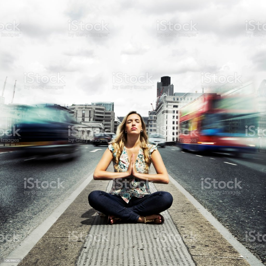 Spirituality and urban zen meditation in a fast paced world stock photo
