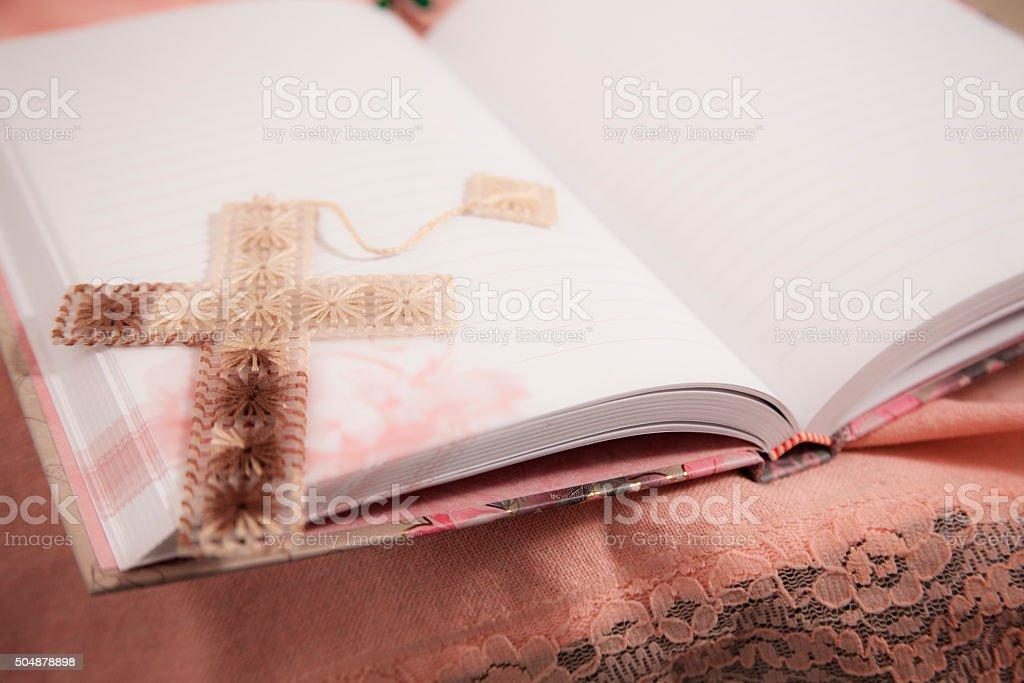Spirituality. Blank, open journal with cross bookmark. Feminine. stock photo
