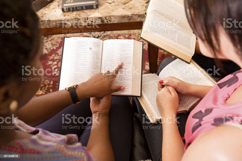 Spirituality: Group of young adult women.  Bible study at home. stock photo