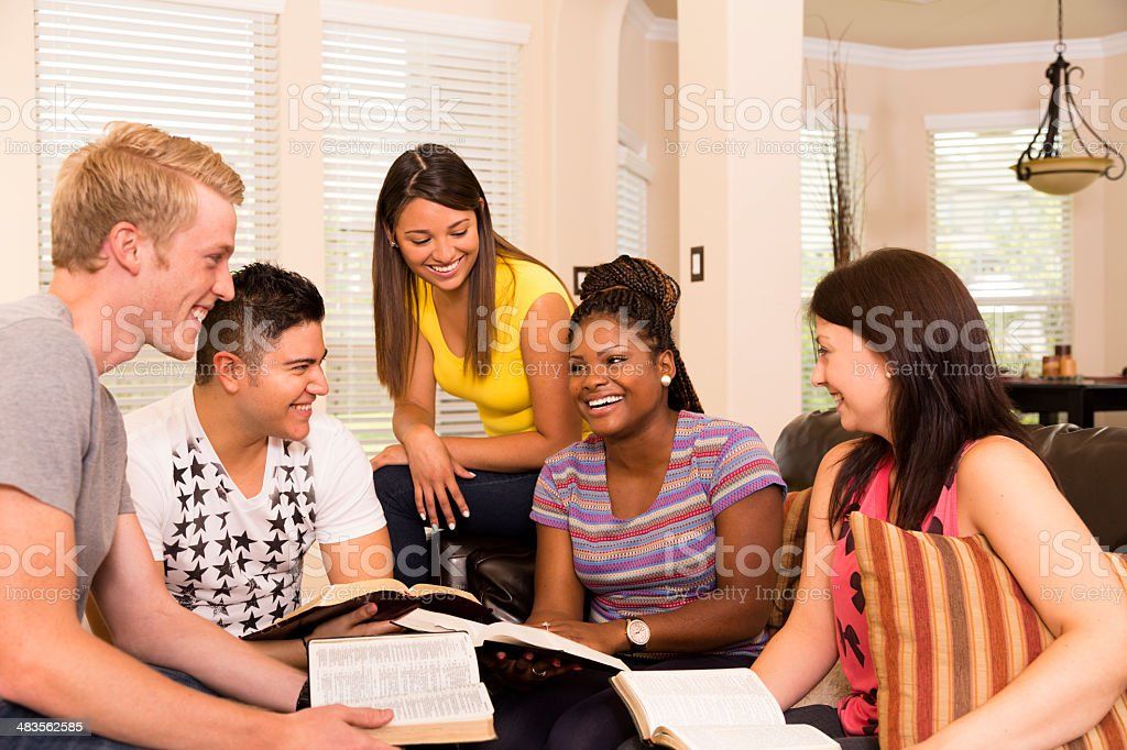 Spirituality:  Group of young adults.  Bible Study in a home. royalty-free stock photo