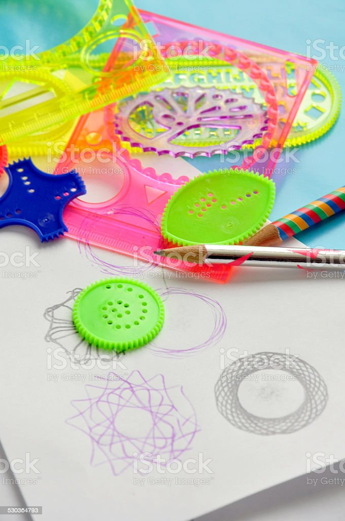 Spirograph Stencils and paper stock photo