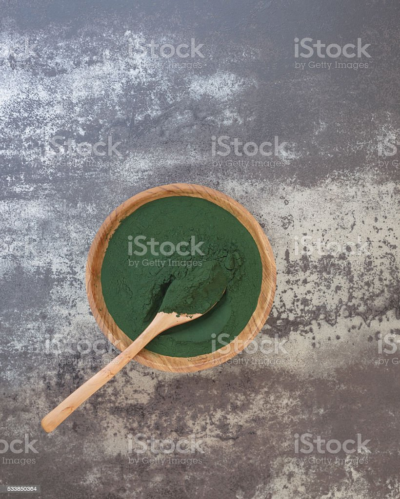 Spirulina Algae Powder in bowl stock photo