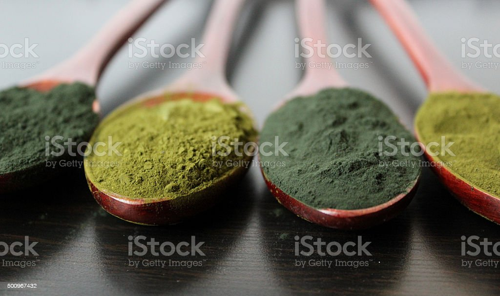 Spirulina and Chorella powder backround stock photo