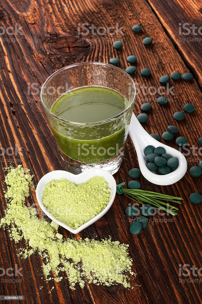 Spirulina, chlorella, barley and wheatgrass. stock photo