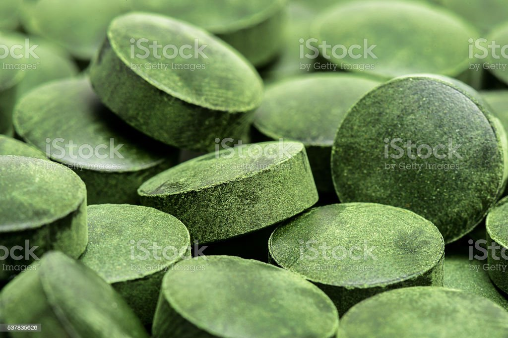 Spirulina pills (superfood) as background. stock photo