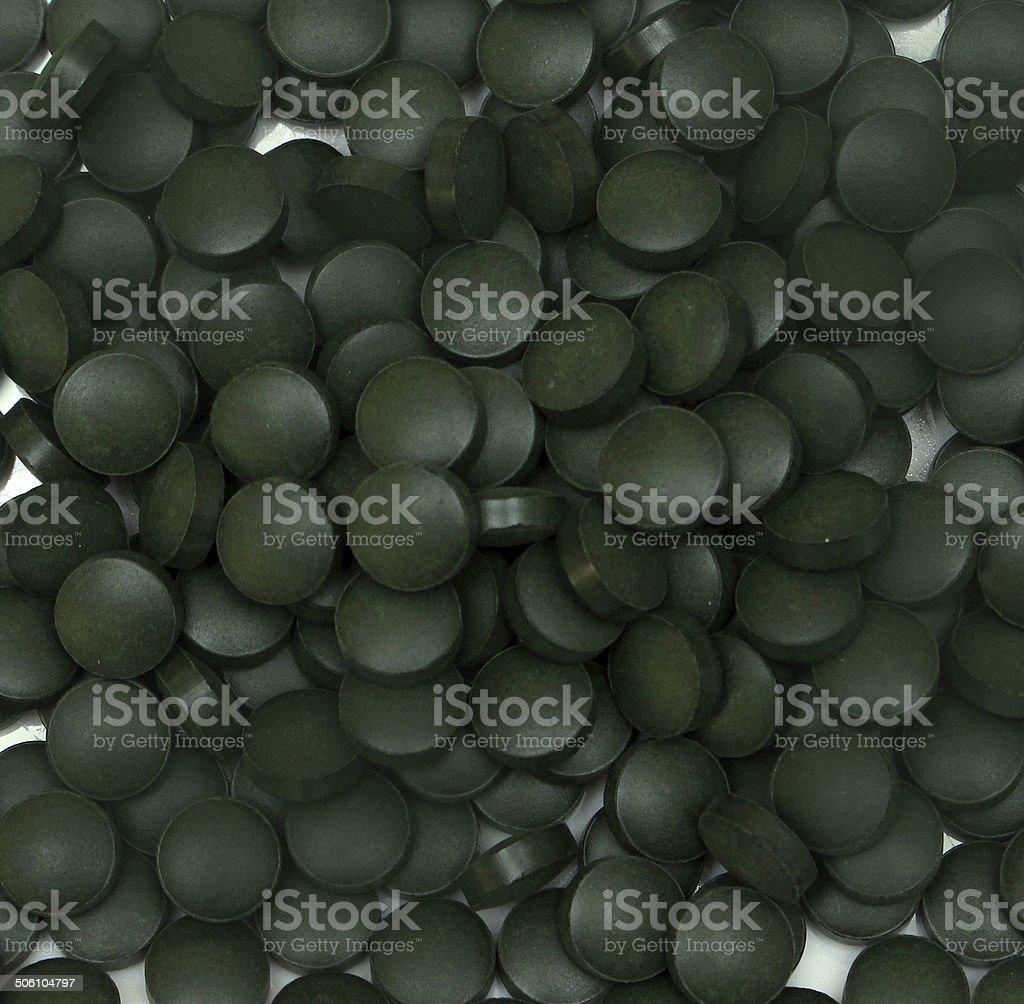 Spirulina pills stock photo