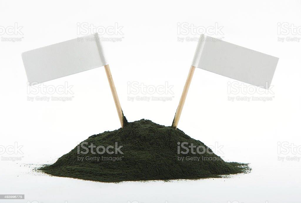 Spirulina powder algae isolated on white background - free space stock photo