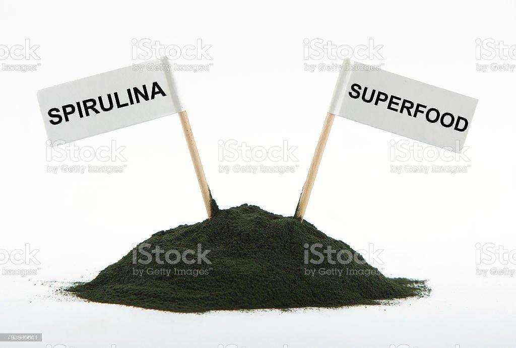 Spirulina powder algae isolated on white background stock photo