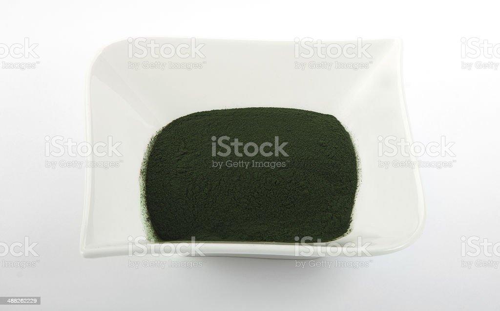 Spirulina powder in bowl on bright background stock photo