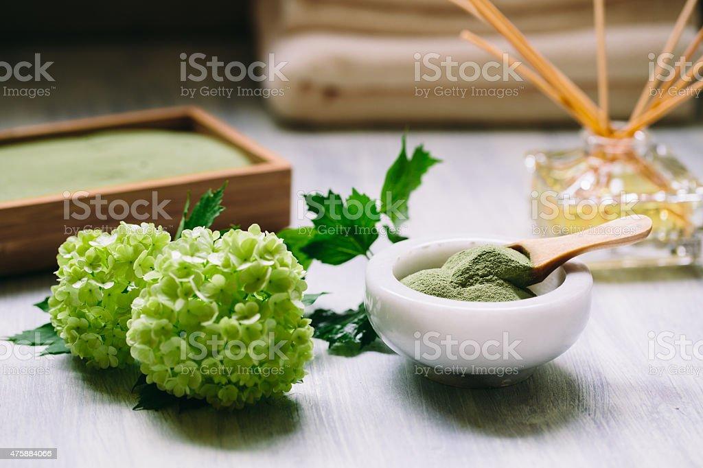 spirulina powder in ceramic bowl stock photo