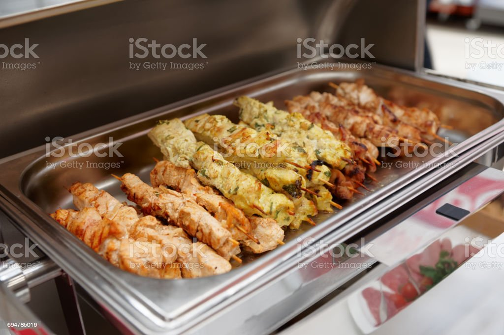 Spit roasted salmon in marmite stock photo