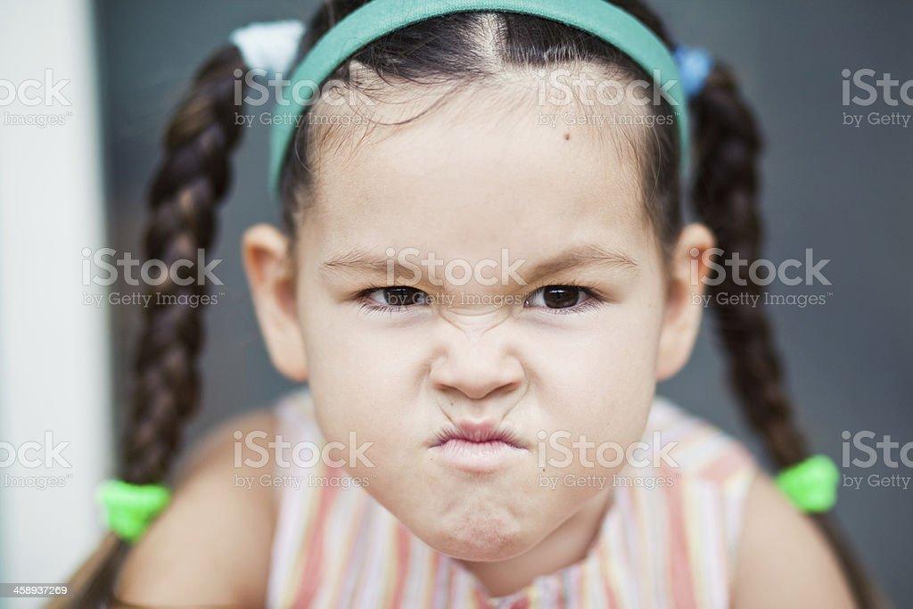 spiteful little girl stock photo