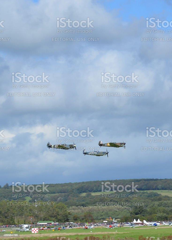 WW2 Spitfire aircraft fly over Goodwood Aerodrome. stock photo