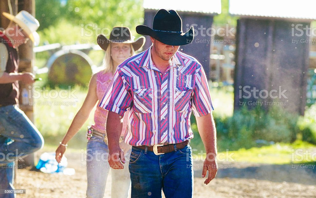 Spitting cowboy at the end of day on ranch stock photo