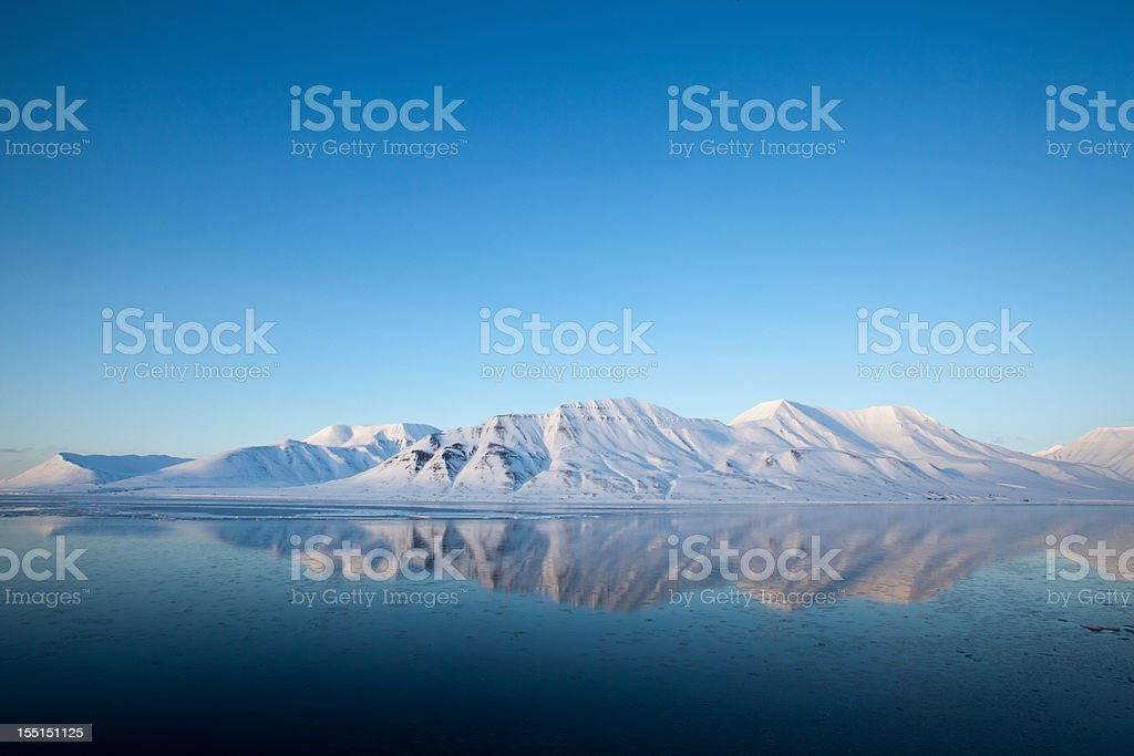 Spitzbergen Mountain reflected on the Isfjord landscape stock photo
