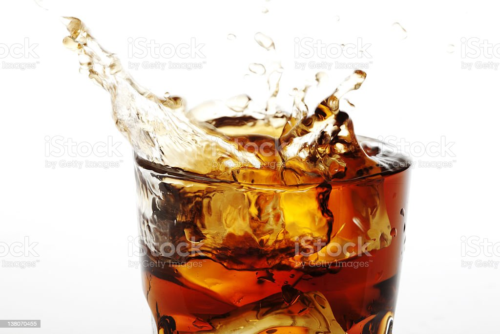 A splash coming from a cup of cola soda royalty-free stock photo