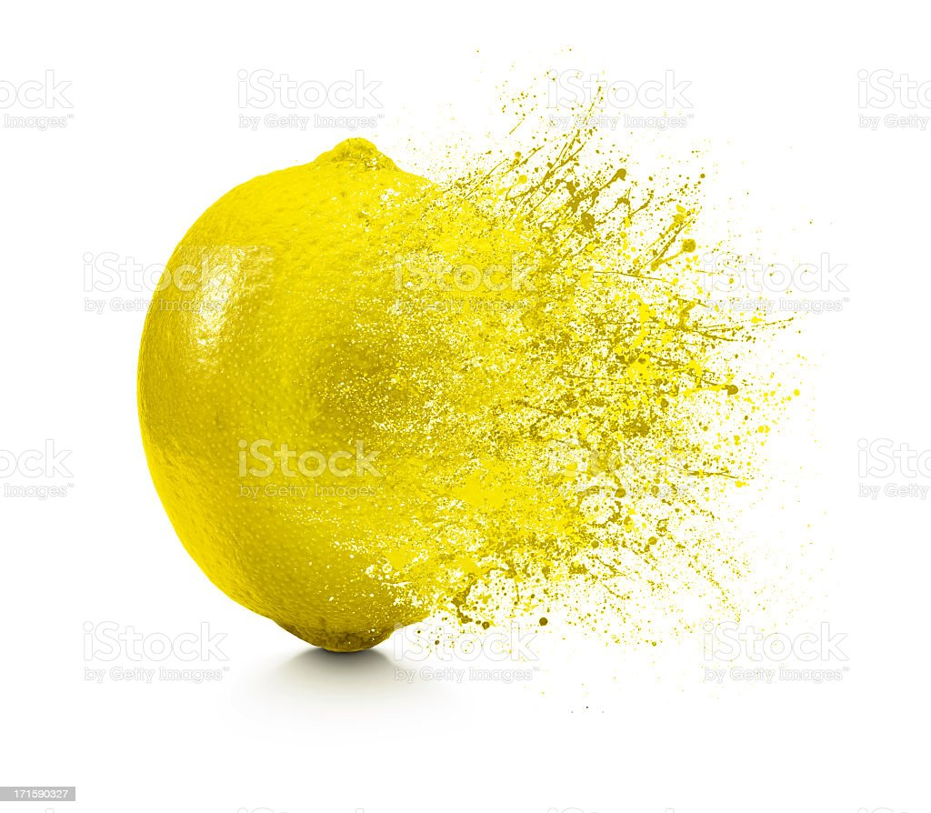 A splash coming off of a lemon on a white background stock photo
