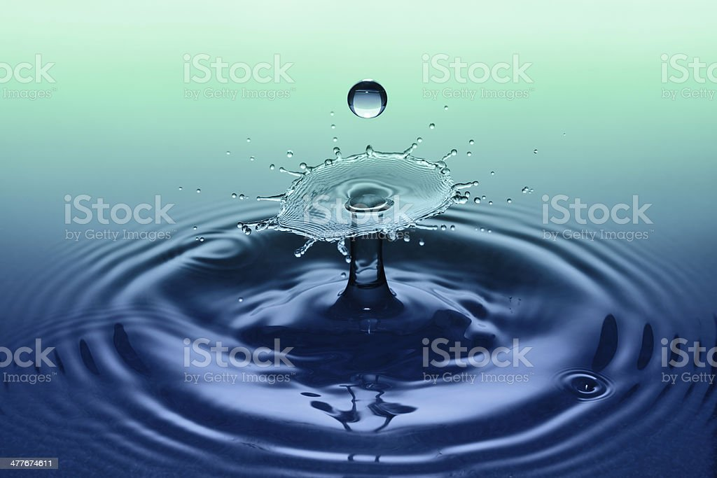 Splash effect after collision of two water drops royalty-free stock photo