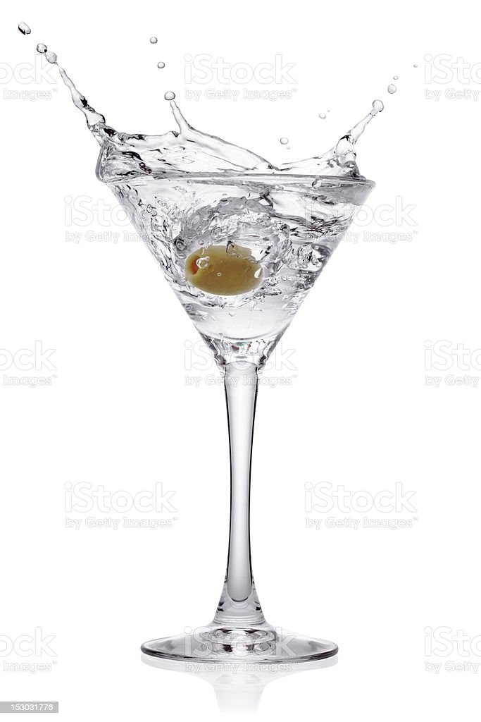 Splash from olive in a glass of cocktail. stock photo