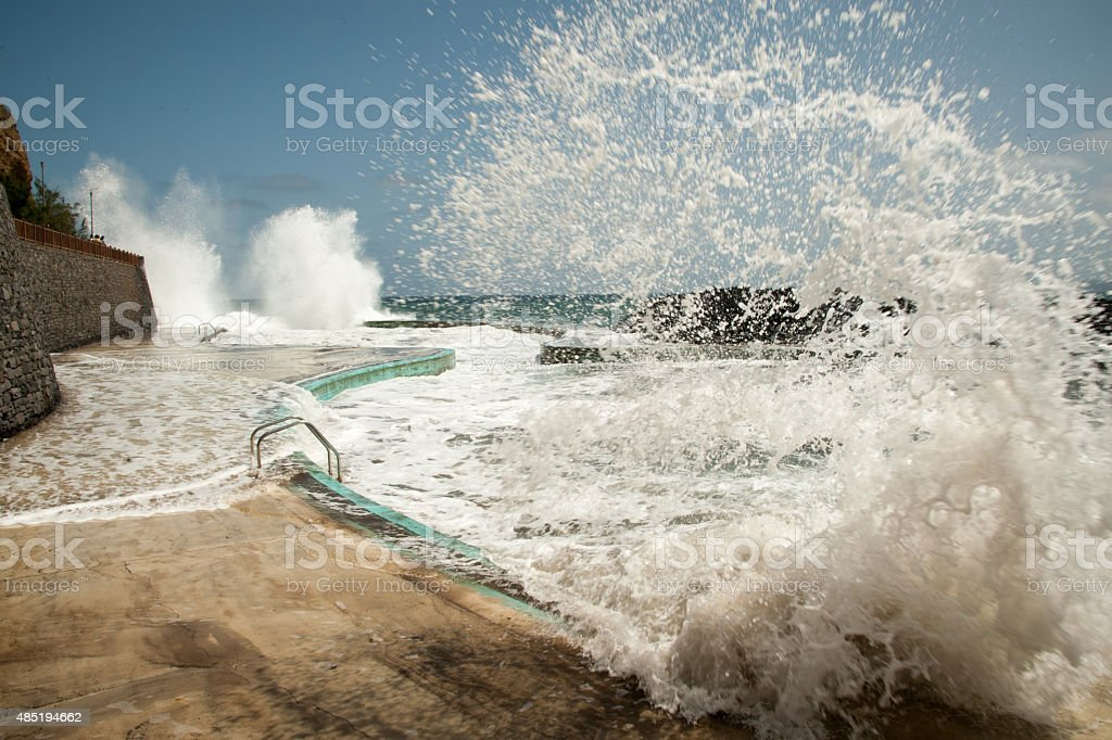 Splash - huge wave in a pool on Madeira stock photo