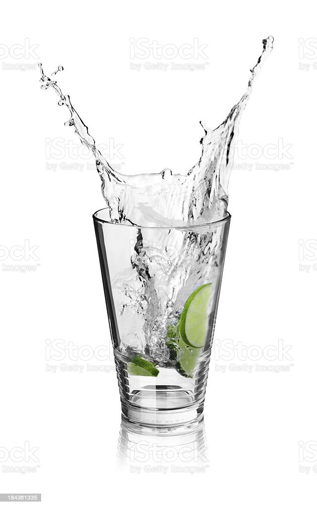 Splash in Ice drink with limes stock photo