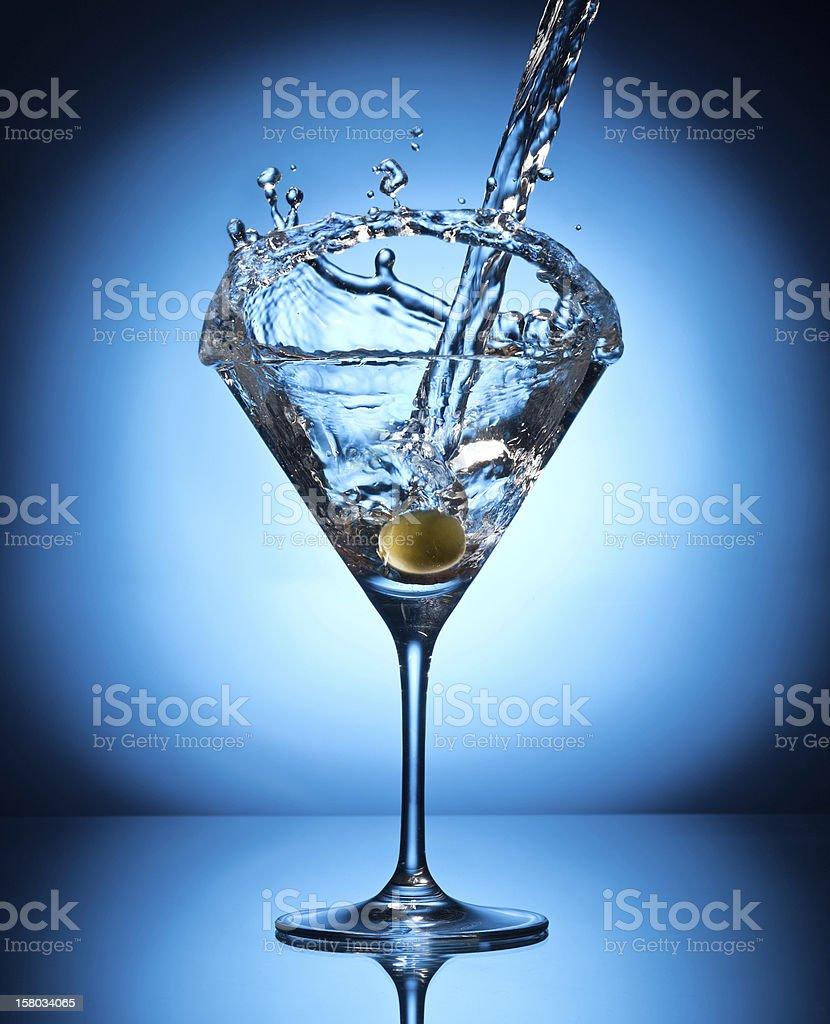 Splash martini from flying olives. royalty-free stock photo