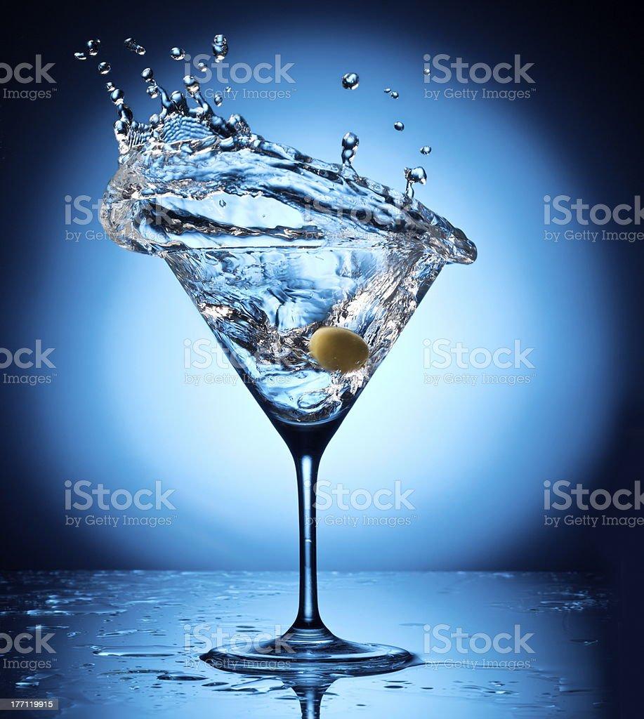 Splash martini from flying olives stock photo