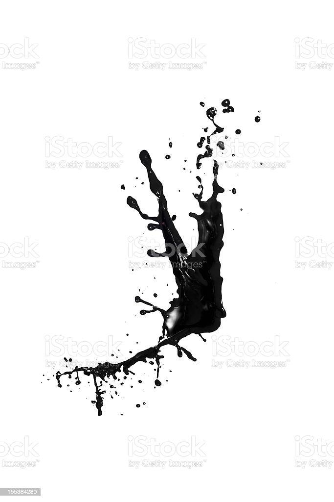 Splash of black liquid on a white background stock photo