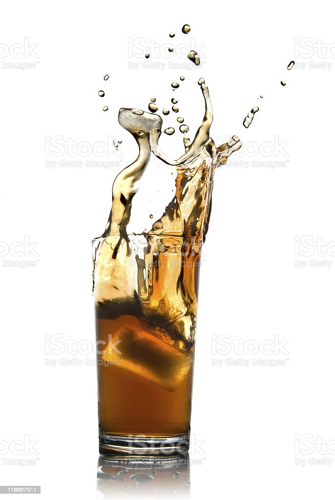 splash of cola in glass royalty-free stock photo