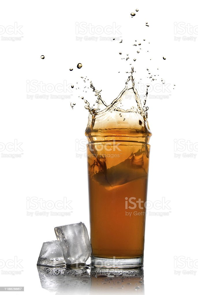splash of cola in glass with ice cubes royalty-free stock photo
