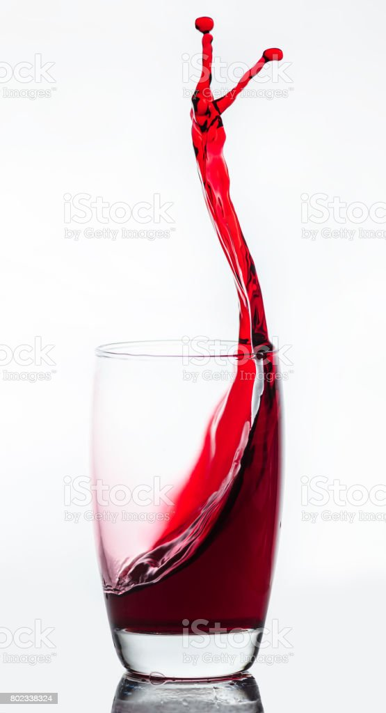 splash of drink from a glass stock photo