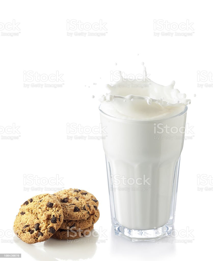 splash of milk glass with cookies stock photo