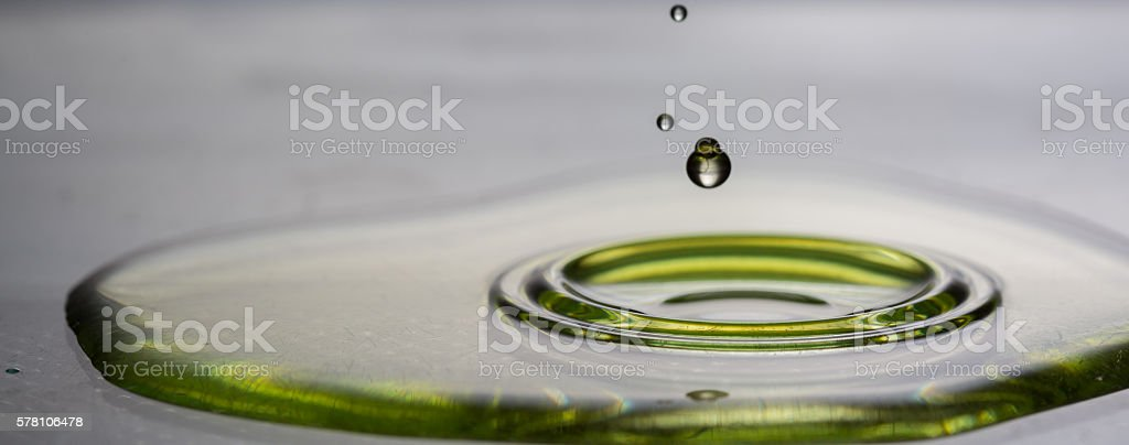 Splash of olive oil on frying pan stock photo