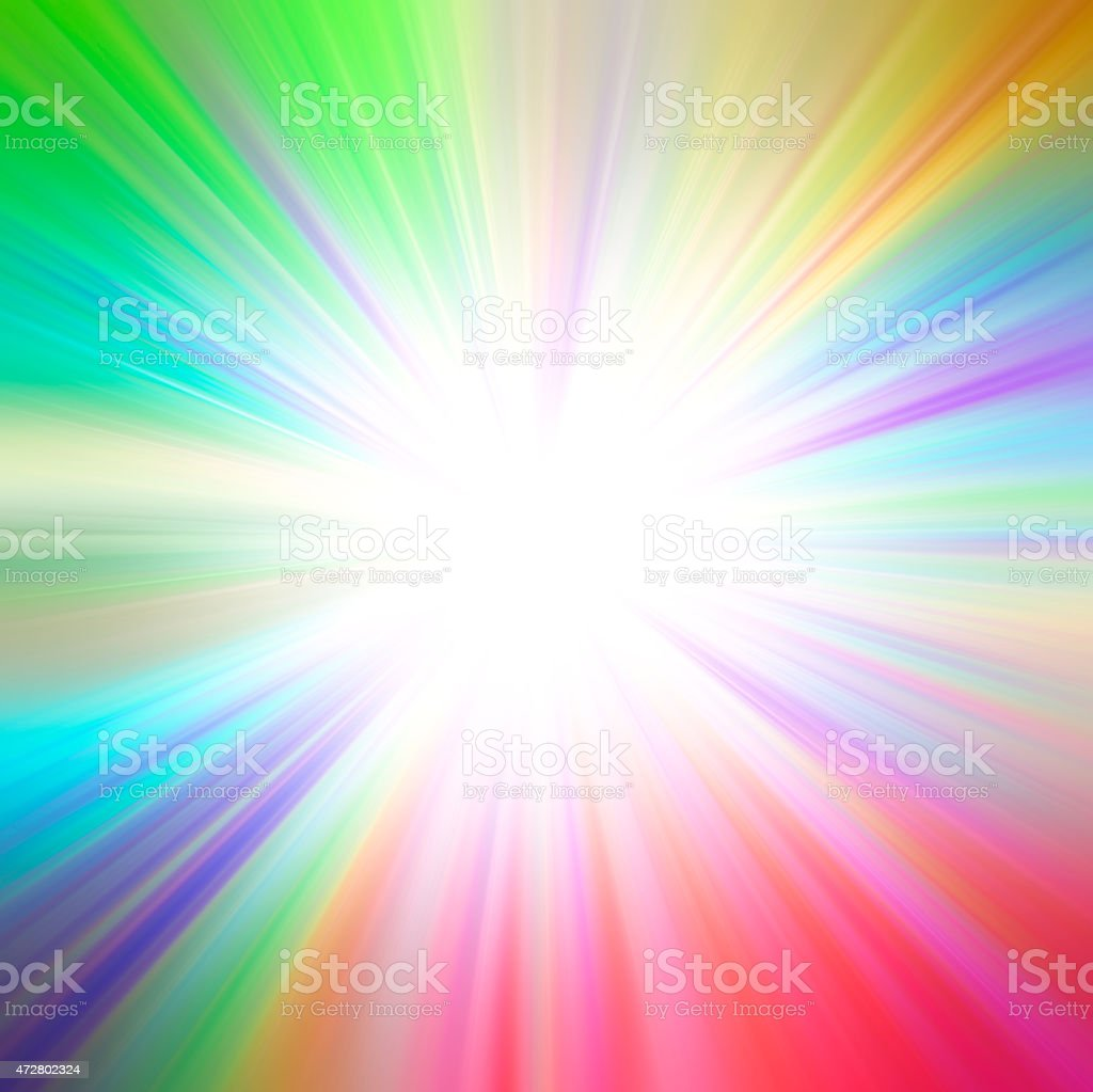 A splash of rainbow colors with a bright inner light stock photo